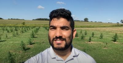 Shuresh Ghimire in hemp field in eastern Connecticut